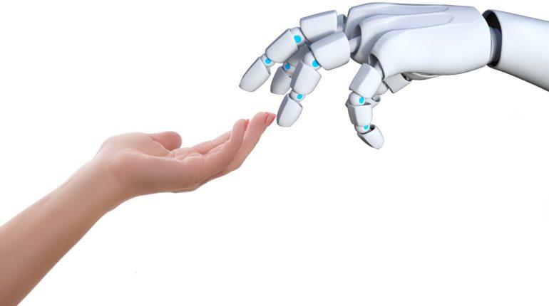 La mano di un robot e di un uomo si toccano per darsi aiuto